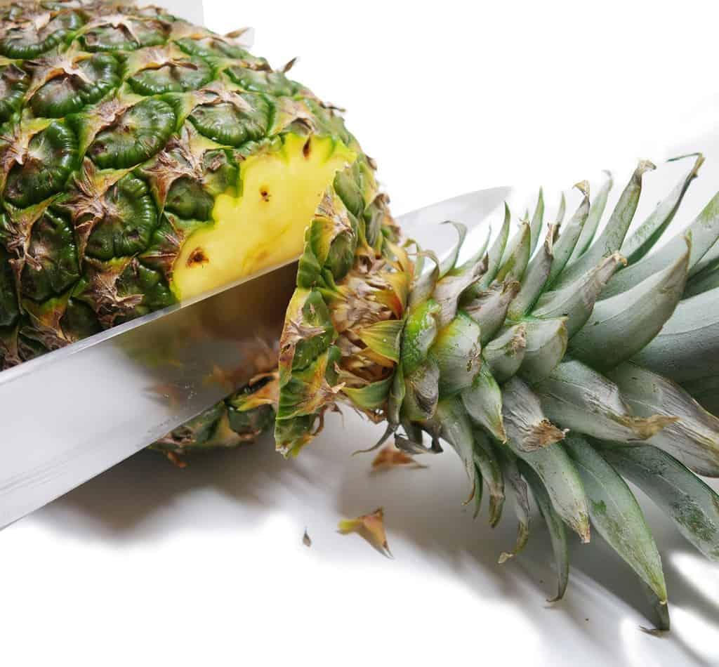 Slicing pineapple top